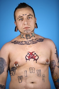 210525-man-with-tattoos-and-piercings